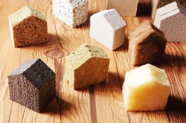 Utilisation de la laine de roche, laine minérale soufflée et ouate de cellulose pour l'isolation